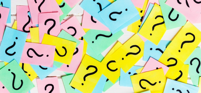 colorful paper notes with question marks. Closeup